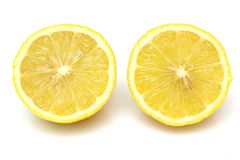 Fresh lemon cut on half isolated on white background Stock Photos