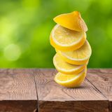 Fresh lemon cuts on wooden table Royalty Free Stock Image