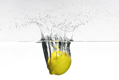 Fresh lemon dropped into water Stock Photos