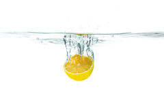 Fresh lemon dropped into water with splash Stock Photo