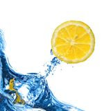 Fresh lemon fly out from blue water stock image