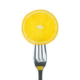 Fresh lemon on fork Royalty Free Stock Image