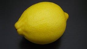 Fresh lemon. Fresh lemon on black background Stock Images
