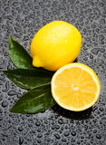 Fresh lemon fruit on wet surface Stock Photography