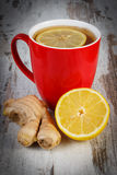 Fresh lemon, ginger and cup of tea on wooden table, healthy nutrition Royalty Free Stock Photos