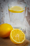 Fresh lemon and glass of clean water with slice of lemon, cold lemonade Stock Photography