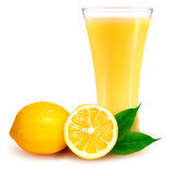Fresh lemon and glass with juice Royalty Free Stock Photo