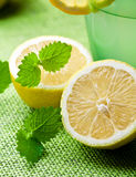Fresh lemon and a glass of limonade Royalty Free Stock Image