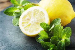 Fresh lemon and green mint on the table Royalty Free Stock Photography