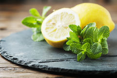 Fresh lemon and green mint on the table Royalty Free Stock Images