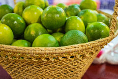 Fresh lemon green in wooden basket Royalty Free Stock Image