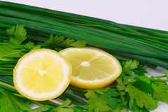 The fresh lemon and greens. For health Stock Image