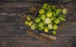 Fresh Lemon. Group of fresh lemon on old wooden background stock image