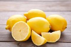 Fresh lemon and half of lemon on grey background. Tropical fruit royalty free stock photography