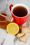 Fresh lemon with honey and cup of tea on wooden table, healthy nutrition Royalty Free Stock Photo