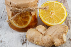 Fresh lemon, honey and ginger on wooden table, healthy food Royalty Free Stock Photography