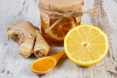 Fresh lemon, honey and ginger on wooden table, healthy nutrition Stock Photos