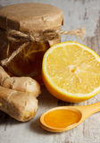 Fresh lemon, honey and ginger on wooden table, healthy nutrition Royalty Free Stock Image