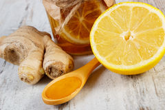 Fresh lemon, honey and ginger on wooden table, healthy nutrition Stock Photo