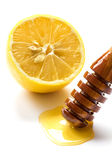 Fresh lemon and honey isolated on white Royalty Free Stock Image