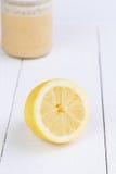 Fresh lemon and honey jar on wooden table. Royalty Free Stock Photography