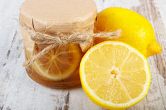 Fresh lemon and honey on wooden table, healthy food and nutrition Stock Images