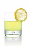 Fresh lemon juice with a slice Royalty Free Stock Images