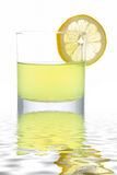 Fresh lemon juice with a slice Royalty Free Stock Image