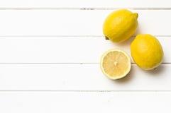 Fresh lemon on kitchen table Royalty Free Stock Photos