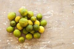 Fresh lemon with leaves. Lemon tree. Box of yellow lemons with fresh lemon tree leaves on wooden background. Top view. Fresh lemon with leaves. Lemon tree. Box stock image