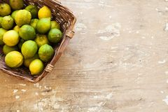 Fresh lemon with leaves. Lemon tree. Box of yellow lemons with fresh lemon tree leaves on wooden background. Top view. Fresh lemon with leaves. Lemon tree. Box royalty free stock images