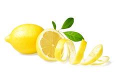 Fresh lemon and lemon peel. On white stock photography