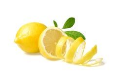 Fresh lemon and lemon peel. On white royalty free stock photo