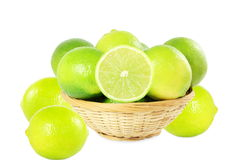 Fresh lemon lime citrus fruit in bamboo basket in white  background Royalty Free Stock Photography