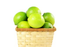 Fresh lemon lime citrus fruit in bamboo basket in white  background Royalty Free Stock Images