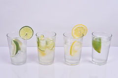 Fresh lemon and lime water. Four glass cups of Fresh lemon and lime water Stock Photo