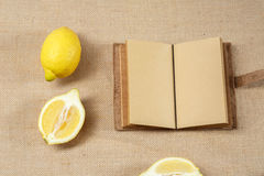 Fresh Lemon and Opened Notebook Stock Images
