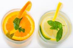 Fresh Lemon and orange juice Stock Photos