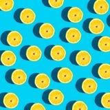 Fresh lemon pattern on a vivid blue background Royalty Free Stock Photos