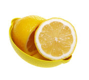 Fresh lemon on a plate. Fresh lemon on a plate, isolated on a white background Royalty Free Stock Photos