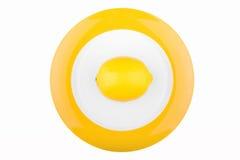 Fresh lemon on a plate isolated on white. Background Royalty Free Stock Image