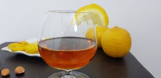 Fresh lemon slice on a glass of brandy royalty free stock images
