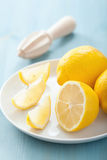Fresh lemon sliced over blue Royalty Free Stock Photography