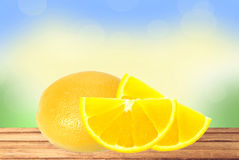 Fresh lemon and slices on wooden table over nature background Stock Image