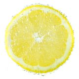 Fresh lemon in soda water covered with bubbles on. Fresh lemon in soda water covered with bubbles isolated on white background Royalty Free Stock Image