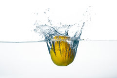 Fresh Lemon Splash in Water Isolated on White Background Royalty Free Stock Image