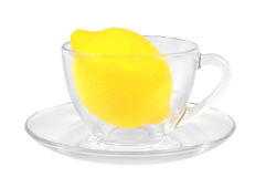 Fresh lemon in a transparent glass cup Stock Image