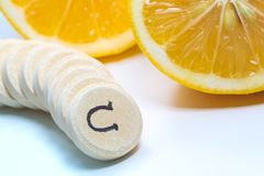 Fresh lemon and Vitamin c tablets royalty free stock photo