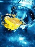 Fresh lemon in water. Fresh lemon splashing in water stock photos