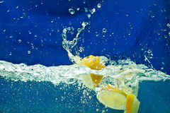 Fresh lemon  in water Royalty Free Stock Images